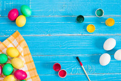 Colorful easter eggs on blue rustic wooden background Royalty Free Stock Photography