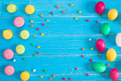 Colorful easter eggs on blue rustic wooden background Royalty Free Stock Image