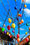 Colorful Easter eggs on blue sky Royalty Free Stock Photography