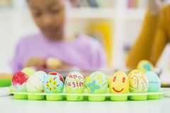 Colorful Easter eggs with blur little girl background royalty free stock images