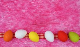 Colorful easter eggs boarder houndstooth ribbon stock photography