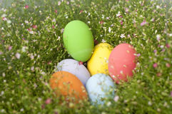 Colorful Easter eggs border by bunch of flowers background Stock Photo