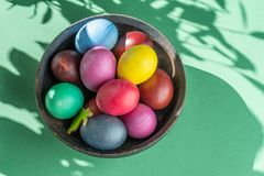 Colorful Easter eggs in bowl. Attribute of Easter celebration stock image