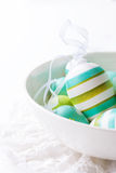 Colorful Easter eggs in a bowl on a bright background Royalty Free Stock Images
