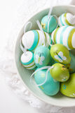 Colorful Easter eggs in a bowl on a bright background Royalty Free Stock Image
