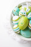 Colorful Easter eggs in a bowl on a bright background Stock Photography