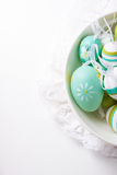 Colorful Easter eggs in a bowl on a bright background Royalty Free Stock Photo