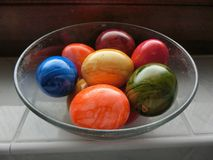 Colorful Easter eggs. Bowl of different colored Easter eggs Stock Photos
