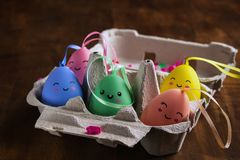 Colorful Easter eggs in box on wooden background royalty free stock photo