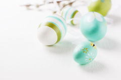 Colorful Easter eggs on a bright background with willow branches and copy space Stock Image