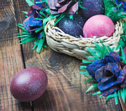 Colorful easter eggs in brown a basket Stock Image