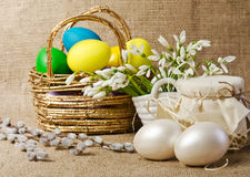 Colorful easter eggs in brown basket Stock Photos