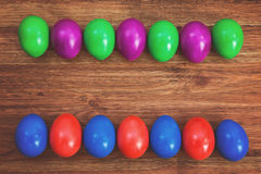 Colorful Easter eggs on brown wooden background Royalty Free Stock Photos