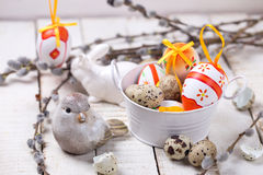 Colorful easter eggs in bucket,  decorative bird and willow  bra Stock Photo