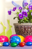 Colorful Easter Eggs bunnies pansies Stock Photos