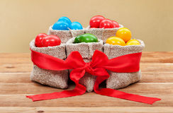 Colorful easter eggs in burlap bags - festive arrangement Royalty Free Stock Image