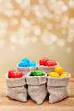 Colorful easter eggs in burlap bags Stock Photos
