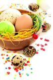 Colorful Easter eggs and cake decorations. Stock Photography