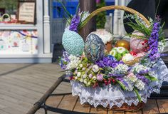 Colorful Easter eggs and Easter cakes in a wicker basket.  royalty free stock photos