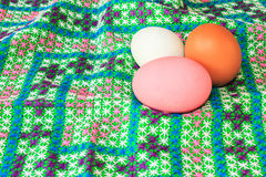colorful easter eggs on canvas Stock Photos