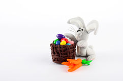 Colorful easter eggs, carrots and rabbit isolated on white Stock Photography