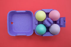 Colorful easter eggs in carton box. Overhead shot of cute easter eggs royalty free stock photo