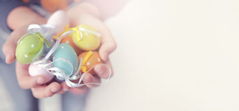 Colorful Easter eggs in child hands with copy space for texts,soft focus and vintage color toned. Colorful Easter eggs in child hands with copy space for texts royalty free stock photos