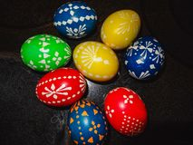 Colorful easter eggs closeup handmade with black background stock photos