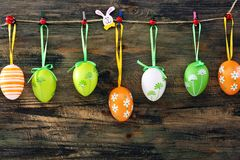 Colorful Easter eggs on a fun clothespins. Royalty Free Stock Images