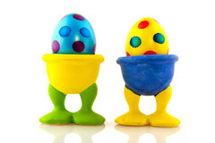Colorful easter eggs in cups stock images