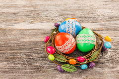 Colorful Easter eggs decorated with lace in small decorative nest. Selective focus Stock Photography