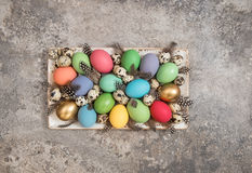 Colorful Easter eggs decoration on stone background Stock Photo