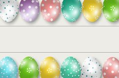 Colorful Easter eggs double edge border on white wooden background Stock Photo