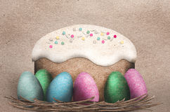 Colorful Easter Eggs and Easter cake Stock Photos