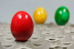Colorful easter eggs on a egg tray. Colorful easter eggs on a range Royalty Free Stock Photography