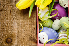 Colorful Easter eggs in festive setting royalty free stock images
