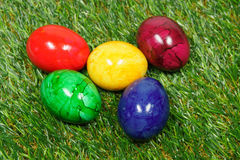 Colorful easter eggs. Five colorful eggs lie on a synthetic grass Royalty Free Stock Photo