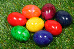 Colorful easter eggs. Five colorful eggs lie on a synthetic grass Stock Image