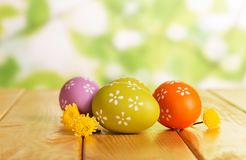 Colorful Easter eggs and florets on abstract green. Colorful bright beautiful Easter eggs and florets on abstract green background Royalty Free Stock Photography