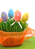 Colorful easter eggs in the flowerbed wih green fresh grass Stock Images