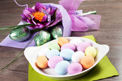 Colorful Easter Eggs with flowers and chocolate eggs Stock Photography