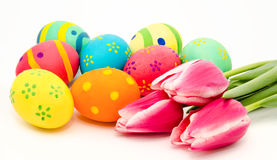 Colorful easter eggs and flowers isolated on a white Royalty Free Stock Photo