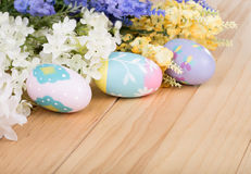 Colorful Easter Eggs and Flowers Royalty Free Stock Photos