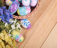 Colorful Easter Eggs and Flowers Stock Photo