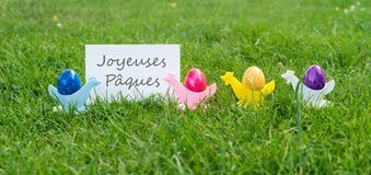 Colorful Easter eggs and french text: happy easter. Easter card with colorful Easter eggs and french text: happy easter Royalty Free Stock Images