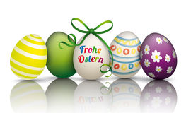 5 Colorful Easter Eggs Frohe Ostern. German text Frohe Ostern, translate Happy Easter Stock Images