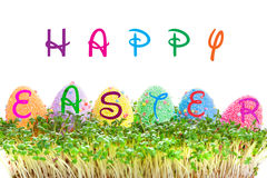 Happy Easter sign on eggs in garden cress Royalty Free Stock Photography