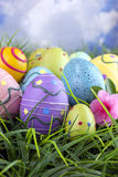 Colorful easter eggs in grass with Azalea blossom Royalty Free Stock Photo