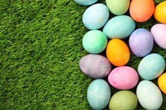 Colorful Easter eggs on grass. Background Stock Photography