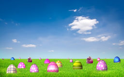 Colorful Easter Eggs on grass field stock photography